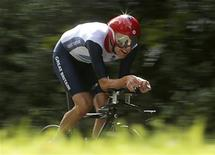 Britain's Bradley Wiggins is seen competing in the men's cycling individual time trial at the London 2012 Olympic Games in this August 1, 2012 file photograph. Wiggins is knighted in the 2013 New Year Honours, it was announced on December 29, 2012. REUTERS/Stefano Rellandini/Files