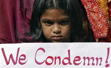 A girl holds a placard as she takes part in a protest rally in Hyderabad December 29, 2012. REUTERS/Krishnendu Halder