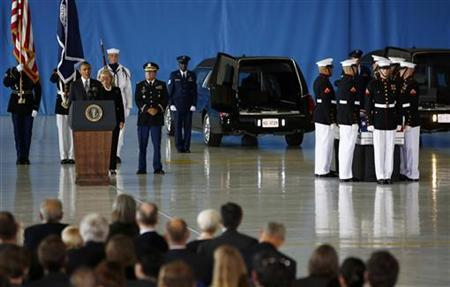 U.S. President Barack Obama and Secretary of State Hillary Clinton participate in a transfer ceremony of the remains of U.S. Ambassador to Libya, Chris Stevens and three other Americans killed this week in Benghazi, at Andrews Air Force Base near Washington, September 14, 2012. Ambassador Stevens and the other Americans died after gunmen attacked the lightly fortified U.S. consulate and a safe house refuge in Benghazi on Tuesday night. REUTERS/Jason Reed