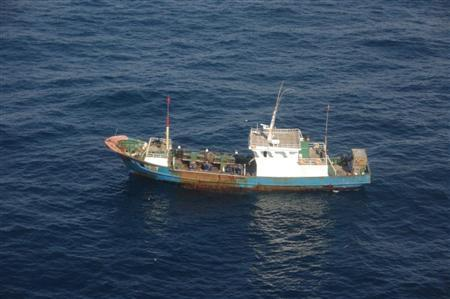 A Chinese fishing boat, which is detained by Japan's coastguard, is seen in this handout photo taken December 29, 2012. Japan's coastguard detained a Chinese fishing boat within Japanese waters on Sunday evening, China's Xinhua news agency said, citing the Chinese consulate general in Fukuoka, a city in southwestern Japan. Picture taken December 29, 2012. REUTERS/Kagoshima Coast Guard Office/Handout