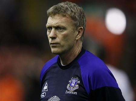 Everton's manager David Moyes watches ahead of their English Premier League soccer match against Liverpool in Liverpool, northern England March 13, 2012. REUTERS/Phil Noble/Files