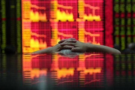 A man looks at an electronic board at a brokerage house in Shanghai August 31, 2009. REUTERS/Aly Song/Files