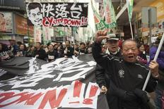 A protester gestures during a protest urging Hong Kong's Chief Executive Leung Chun-ying to step down, on a street in Hong Kong's shopping Causeway Bay district January 1, 2013. REUTERS/Tyrone Siu
