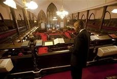 LaMonte Thomas of North Charleston, South Carolina, stands in the choir balcony just before the start of the Watch Night service at Emanuel African Methodist Episcopal Church in Charleston, South Carolina December 31, 2012. REUTERS/Randall Hill
