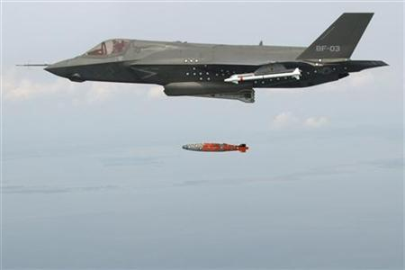 BF-3, a short take-off and vertical landing F-35 Lightning II, releases an inert 1,000 lb. GBU-32 Joint Direct Attack Munition (JDAM) separation weapon over water in an Atlantic test range in Patuxent River, Maryland August 8, 2012. REUTERS/Andy Wolfe/Lockheed Martin/Handout