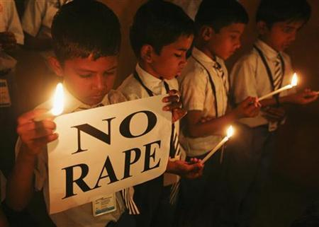 Students hold candles as they pray during a candlelight vigil for a gang rape victim who was assaulted in New Delhi, in Ahmedabad December 31, 2012. REUTERS/Amit Dave