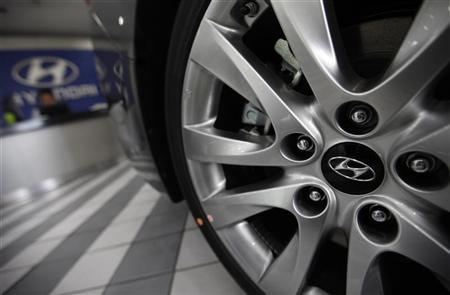 The logo of Hyundai Motor is seen on the wheel of a car at a Hyundai dealership in Seoul July 26, 2012. REUTERS/Kim Hong-Ji
