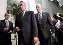"""Speaker of the House John Boehner (R-OH) (front, in green tie) walks with Congressman Dave Camp (R-MI) (R) after a meeting with House Republicans about a """"fiscal cliff"""" deal on Capitol Hill in Washington January 1, 2013. REUTERS/Joshua Roberts"""
