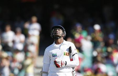 Sri Lanka's Lahiru Thirimanne reacts after being dismissed by Australia's Nathan Lyon during the first day's play of their third cricket test match at the Sydney Cricket Ground January 3, 2013. REUTERS/Tim Wimborne