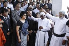 Chief Justice Shirani Bandaranayake (front L) is blessed by Christian priests before leaving the Supreme Court for the Parliament to appear before the Parliamentary Select Committee (PSC) appointed to look into impeachment charges against her, in Colombo December 4, 2012. REUTERS/Stringer