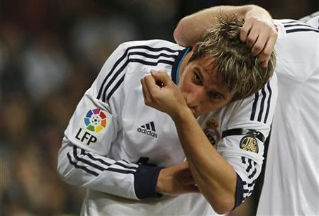Real Madrid's Fabio Coentrao celebrates his goal during their Spanish First Division soccer match against Espanyol at Santiago Bernabeu Stadium in Madrid December 16, 2012. REUTERS/Juan Medina