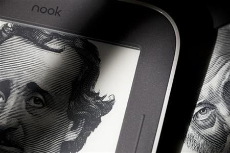 Portraits of Edgar Allan Poe and Walt Whitman are shown on the home screens of Nook readers from Barnes & Noble, which use technology developed by E Ink Corporation, in Cambridge, Massachusetts October 25, 2012. REUTERS/Dominick Reuter/Files