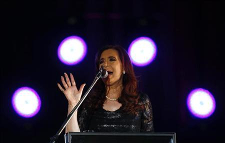 Argentina's President Cristina Fernandez de Kirchner speaks during celebrations of the Day of Democracy and International Human Rights Day outside the Casa Rosada Presidential Palace in Buenos Aires December 9, 2012. REUTERS/Marcos Brindicci