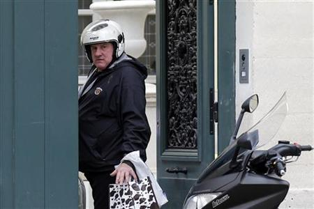 French actor Gerard Depardieu enters his home in Paris December 19, 2012. REUTERS/Benoit Tessier