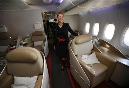 File photo of an Air France KLM flight attendant in the first class cabin of new Airbus A380 aircraft during a hand-over ceremony at the manufacturer's site in Finkenwerder near Hamburg October 30, 2009. REUTERS/Christian Charisius