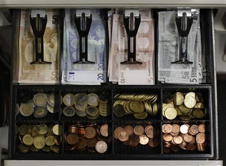 Euro banknotes and small coins are pictured in open cash register in a shop in Olching August 16, 2011. REUTERS/Michaela Rehle (GERMANY - Tags: BUSINESS) POLITICS)