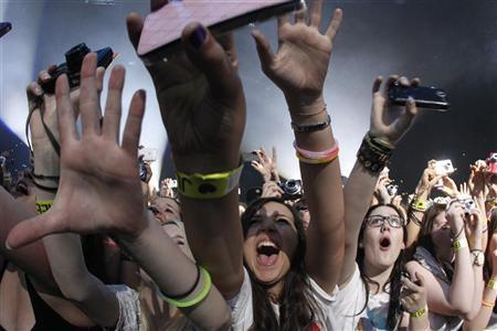 Fans react as Canadian singer Justin Bieber performs during his concert at the Hallenstadion in Zurich, April 8, 2011. REUTERS/Christian Hartmann