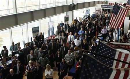 Job applicants listen to a presentation prior to the opening of a job fair for veterans and their spouses held by the U.S. Chamber of Commerce and the Washington Nationals baseball club at Nationals Park in Washington December 5, 2012. REUTERS/Gary Cameron