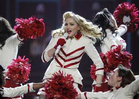 U.S. pop singer Madonna performs during the opening night concert for the North America part of her MDNA world tour in Philadelphia, Pennsylvania, August 28, 2012. REUTERS/Tim Shaffer