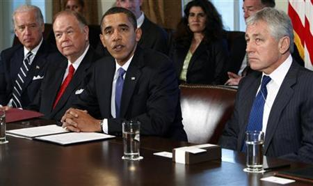 U.S. President Barack Obama (2nd R) and Vice President Joe Biden (L) meet with co-chairmen of the President's Intelligence Advisory Board former Senator Chuck Hagel (R-NE) (R) and former Senator David Boren (D-OK) and senior leadership of the intelligence community in the Cabinet Room at the White House in Washington October 28, 2009. REUTERS/Jim Young/Files