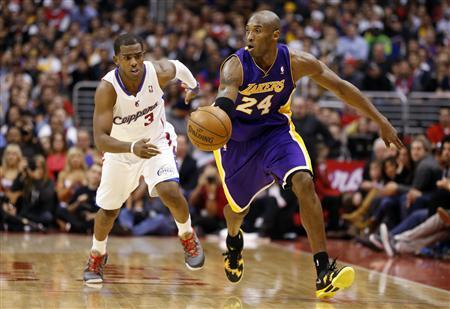 Los Angeles Lakers' Kobe Bryant (R) drives past Los Angeles Clippers' Chris Paul during the second half of their NBA basketball game in Los Angeles January 4, 2013. REUTERS/Danny Moloshok