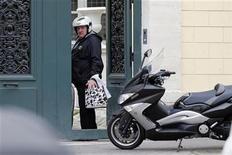 French actor Gerard Depardieu enters his home in Paris December 19, 2012. REUTERS/Benoit Tessier