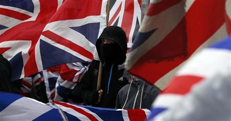 Man arrested after shots fired at Northern Irish police in flag riots