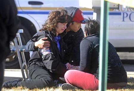 An unidentified woman reacts outside a townhouse complex following an overnight hostage-taking incident in Aurora, Colorado January 5, 2013. REUTERS/Evan Semon