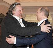 Russian President Vladimir Putin (R) greets French actor Gerard Depardieu during their meeting in Sochi January 5, 2013. REUTERS/Mikhail Klimentyev/RIA Novosti/Pool