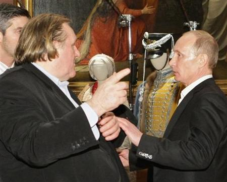 French actor Gerard Depardieu (L) speaks with Vladimir Putin (R), then Russian Prime Minister, during a meeting in St.Petersburg in this December 11, 2010 file photo. Russian President Vladimir Putin has granted citizenship to Depardieu, the French movie star who quit his homeland to avoid a tax hike on the rich, the Kremlin said on January 3, 2013. Picture taken December 11, 2010. REUTERS/Alexei Nikolsky/RIA Novosti/Pool/Files (RUSSIA - Tags: ENTERTAINMENT POLITICS SOCIETY IMMIGRATION)