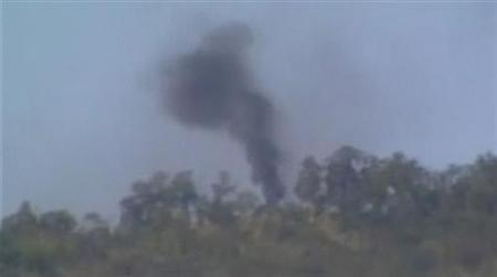 Smoke is seen rising from a mountain in Kachin state in this still image taken from a video dated December 27, 2012. REUTERS/Courtesy of Democratic Voice of Burma/Handout
