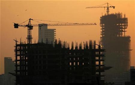 Buildings under construction are seen along the Mumbai skyline November 23, 2008. REUTERS/Arko Datta/Files