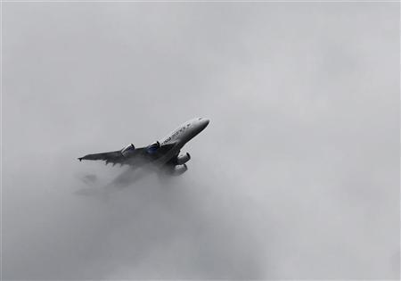 An Airbus A380 flies through cloud during a display flight at the Farnborough Airshow 2012 in southern England July 9, 2012. REUTERS/Luke MacGregor