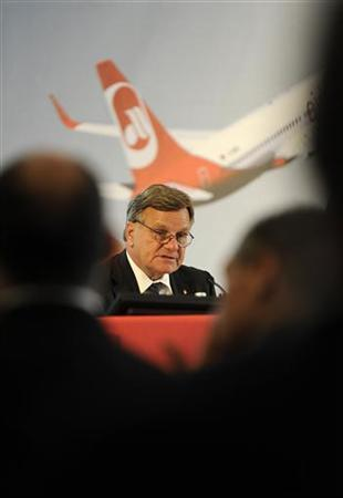 Hartmut Mehdorn, CEO of airberlin, listens to a contribution from a shareholder at the low cost airline's annual general meeting at a hotel near Stansted airport, near London, June 7, 2012. REUTERS/Paul Hackett (BRITAIN - Tags: BUSINESS TRANSPORT)