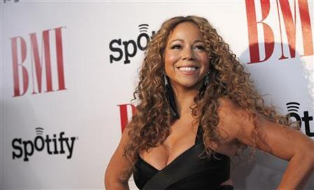 Recording artist Mariah Carey poses as she arrives at BMI's annual Urban Music Awards at the Saban theatre in Beverly Hills, California September 7, 2012. REUTERS/Mario Anzuoni