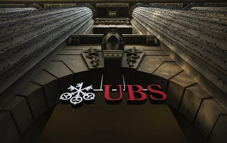 A logo of Swiss bank UBS is seen on a building in Zurich December 19, 2012. REUTERS/Michael Buholzer