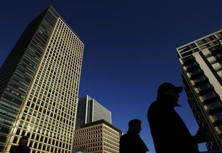 People walk through the the Canary Wharf business district in London February 3, 2012. REUTERS/Luke MacGregor