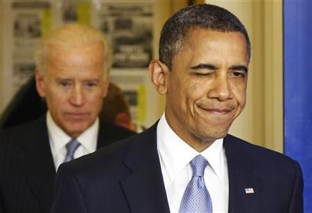 U.S. President Barack Obama winks as he arrives with Vice President Joe Biden (L) in the briefing room to make remarks after the House of Representatives acted on legislation intended to avoid the ''fiscal cliff,'' at the White House in Washington January 1, 2013. REUTERS/Jonathan Ernst