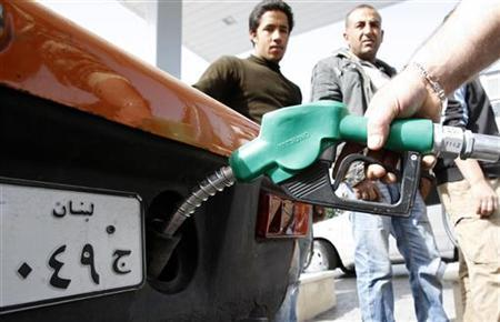 A worker pumps petrol into a customer's car at a fuel station in Sidon, southern Lebanon, February 25, 2011. REUTERS/ Ali Hashisho/Files