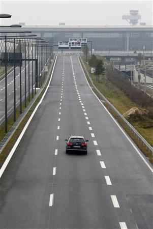 A car drives to the construction site of the future Berlin Brandenburg international airport Willy Brandt (BER) in Schoenefeld, January 7, 2013. REUTERS/Fabrizio Bensch (GERMANY - Tags: BUSINESS TRANSPORT)
