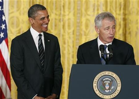 U.S. President Barack Obama smiles at his nominee for Secretary of Defense, former Republican Senator Chuck Hagel (R), at the White House in Washington January 7, 2013. REUTERS/Kevin Lamarque