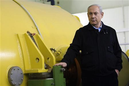 Israel's Prime Minister Benjamin Netanyahu stands next to a free-electron laser (FEL) during a visit to the Ariel University Centre in the West Bank Jewish settlement of Ariel January 8, 2013. Israel upgraded the Ariel campus to a university last month, a move that has put the school at the centre of a debate at the core of the Israeli-Palestinian conflict: how the settlements will figure in defining a future Palestinian state. REUTERS/Dan Balilty/Pool
