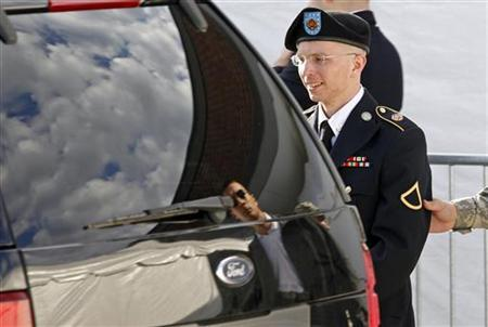 Army Private First Class Bradley Manning is escorted in handcuffs as he leaves the courthouse in Fort Meade, Maryland June 6, 2012. REUTERS/Jose Luis Magana/Files