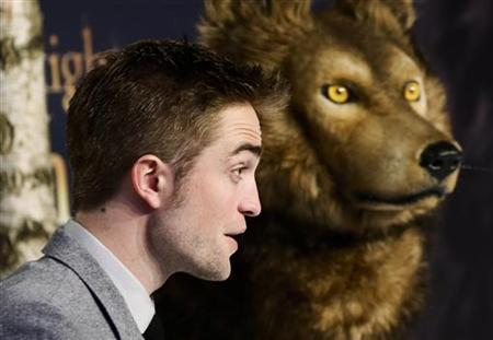 Cast member Robert Pattinson poses for pictures before the German premiere of The Twilight Saga: Breaking Dawn Part 2 in Berlin, November 16, 2012. REUTERS/Thomas Peter