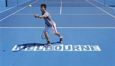 Japan's Kei Nishikori catches a tennis ball during a practice session at Melbourne Park January 9, 2013, ahead of the Australian Open tennis tournament which begins on Monday. REUTERS/Tim Wimborne