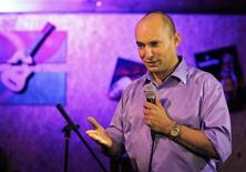 Naftali Bennett, head of the Beit Yehudi (Jewish Home) party, campaigns at a bar in the southern city of Ashdod December 27, 2012. A Palestinian state would be suicide for Israel, says Bennett, a high-tech millionaire who heads a far-right party whose popularity has been the surprise of the country's election campaign. Picture taken December 27, 2012. REUTERS/Amir Cohen