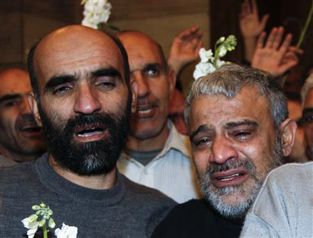 Iranians released by Syrian rebels arrive at a hotel in Damascus January 9,2013. Forty eight Iranians released by Syrian rebels in exchange for the release of more than 2,000 civilian prisoners held by the Syrian government arrived at the Sheraton hotel in central Damascus on Wednesday, a Reuters witness said. The men were accompanied by the Iranian ambassador to Syria and arrived in six small buses, looking tired but in good health. REUTERS/Khaled al-Hariri