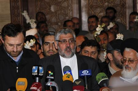 Iranian Ambassador in Syria Mohammad Riza Shibani speaks to the media after Iranians released by Syrian rebels arrived at a hotel in Damascus January 9, 2013. Forty eight Iranians released by Syrian rebels in exchange for the release of more than 2,000 civilian prisoners held by the Syrian government arrived at the Sheraton hotel in central Damascus on Wednesday, a Reuters witness said. The men were accompanied by the Iranian ambassador to Syria and arrived in six small buses, looking tired but in good health. REUTERS/Khaled al-Hariri
