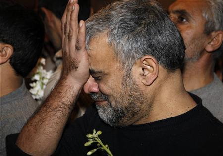 An Iranian released by Syrian rebels cries upon his arrival to a hotel in Damascus January 9, 2013. Forty eight Iranians released by Syrian rebels in exchange for the release of more than 2,000 civilian prisoners held by the Syrian government arrived at the Sheraton hotel in central Damascus on Wednesday, a Reuters witness said. The men were accompanied by the Iranian ambassador to Syria and arrived in six small buses, looking tired but in good health. REUTERS/Khaled al-Hariri