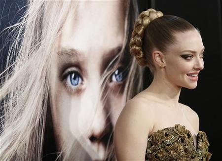 Actress Amanda Seyfried arrives for the premiere of Les Miserables in New York, December 10, 2012. REUTERS/Carlo Allegri/Files